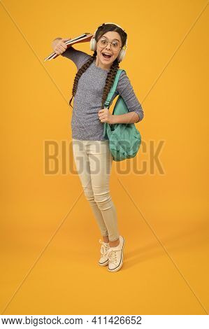 Welcome Back To School. Happy Child Carry Backpack Yellow Background. Little Girl Back To Study. Bac