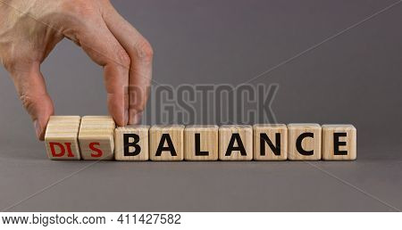 Balance Or Disbalance Symbol. Businessman Turns Cubes And Changes The Word Disbalance To Balance. Be