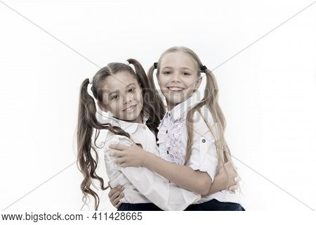 School Friendship Is So Special. Adorable Small Friends Hugging Isolated On White. Happy Schoolgirls
