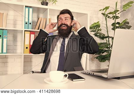 Stay Happy. Businessman Listen To Music At Workplace. Businessman Wear Headphones In Office. Bearded