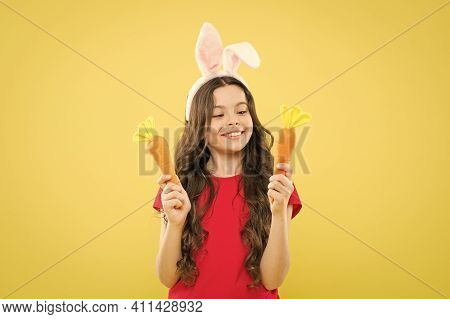Playful Child Yellow Background. Holy Week Activities. Healthy Food. Child Bunny Ears. Diet For Heal