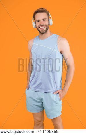 Man Handsome Unshaven Sportsman Listening Music Headphones Gadget. Sport Is Better With Music. Worko