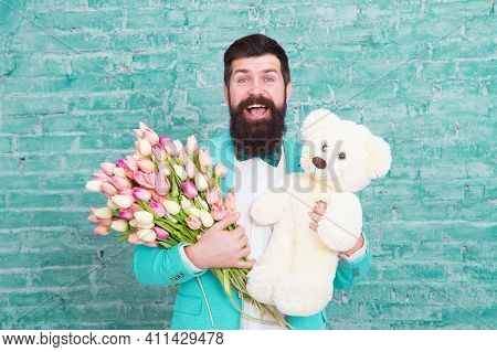 Nice Bouquet. Flower For March 8. Love Date. International Holiday. Bearded Man With Tulip Bouquet A