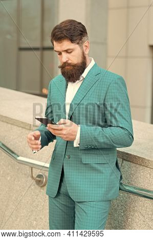 Contact List. Online Business. Bearded Man With Smartphone. Handsome Cool Businessman Using Smartpho