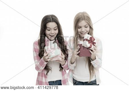 Intriguing Moment. Birthday Present. Girls Sisters Or Friends Hold Gift Boxes. Small Girls Open Holi