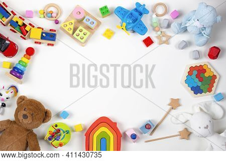 Baby Kids Toys Frame. Set Of Colorful Educational Wooden And Fluffy Toys On White Background. Top Vi