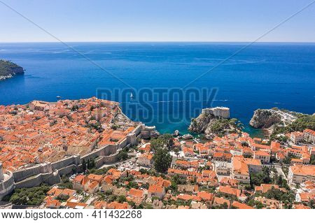 Aerial Drone Shot Of West City Wall Of Dubrovnik Old Town By Adriatic Sea In Croatia Summer Noon