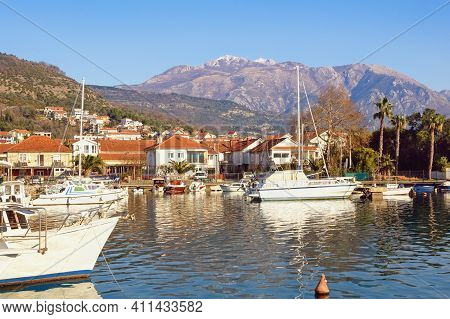 Beautiful Winter Mediterranean Landscape. Fishing Boats In Harbor At Foot Of Mountain. Montenegro, T