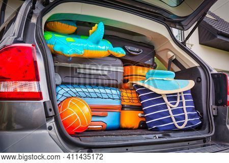 Baggages in the car trunk packed and ready to go for holidays
