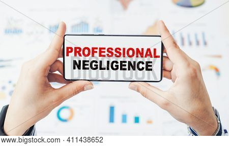 Closeup On Businessman Holding A Smartphone With Text Professional Negligence.