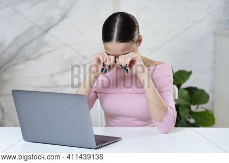 Tired Sleepy Girl, Young Unhappy Woman Is Rubbing, Massaging Her Eyes After Long Working On Laptop C