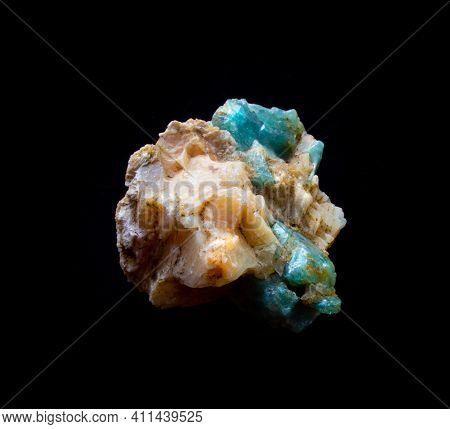 Aquamarine Gemstone Crystal Inside Feldspar Rock Isolated On Black. For Geology Mineralogy Magazines