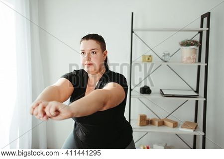 Home Fitness. Woman Doing Physical Exercises In Her Living Room. Weight Loss, Healthy And Active Lif