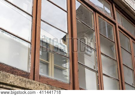 Wooden Weathered Windows Of The Balcony Of A Historic Building. Close-up
