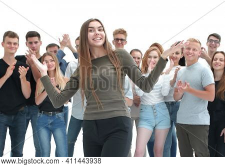 happy friendly girl standing in front of a group of her friends.