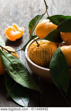 Fresh Ripe Juicy Yellow Mandarin ( Clementine, Tangerine ) On Rustic Vintage Table With Leaf. Winter