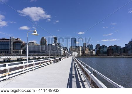 Pier 34 Along Hudson River Overlooking Tribeca Buildings In Manhattan. New York City Skyline View.