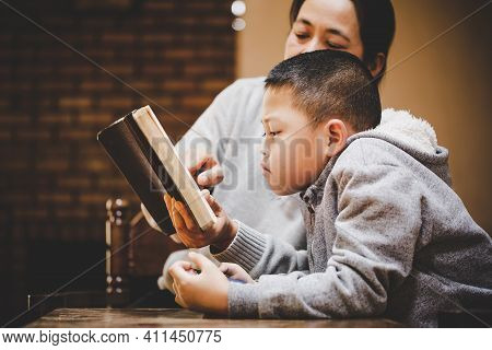 Mother And Son Praying And Praising God At Home