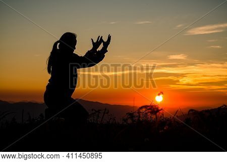Silhouette Of Christian Woman Praying