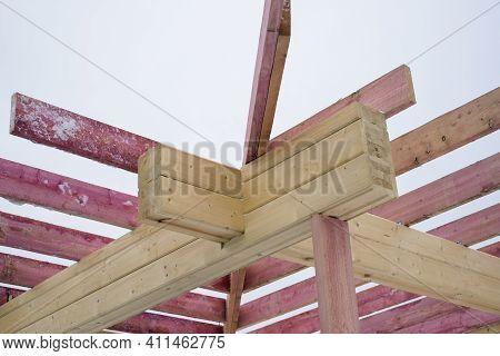 Unfinished Roof Rafters Arrangemenrt Against The Sky, Winter Scene