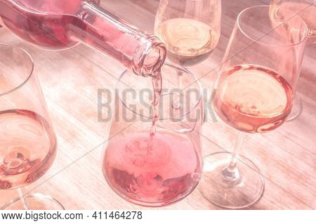 Rose Wine Pouring, Toned Image With Many Glasses