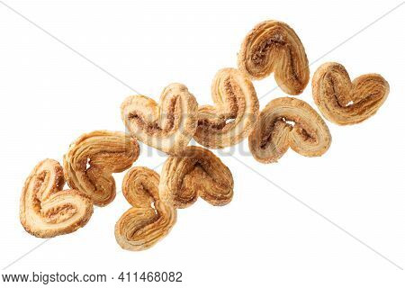 Falling Crunchy Cookies With Sugar And Cinnamon, Isolated On White Background