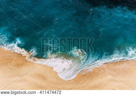 Wild Beach With A Beautiful Clear Ocean. Ocean From A Bird's Eye View. Top View Of The Tropical Beac