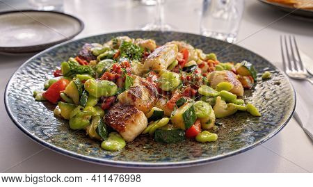A Meal Of House Made Gnocchi Presented On A Decorative Plate