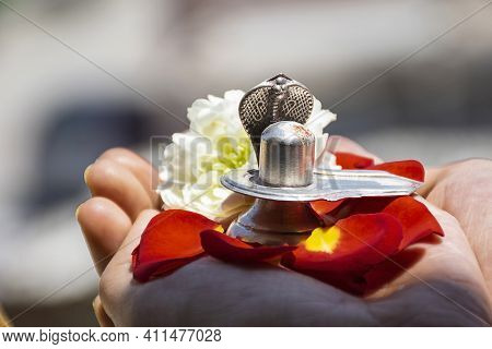 Stock Photo Of A Man Holding And Worshiping Silver Shivlinga Which Is Icon Of Lord Shiva On The Occa