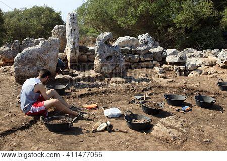 Torre D'en Galmés, Menorca / Spain - June 23, 2016: Archaeologist In Prehistoric Area At Torre D'en