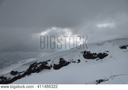 Caucasus Mountains And Glaciers In Cloudy Cloudy Weather In The Evening. Calm Not Colorful Landscape