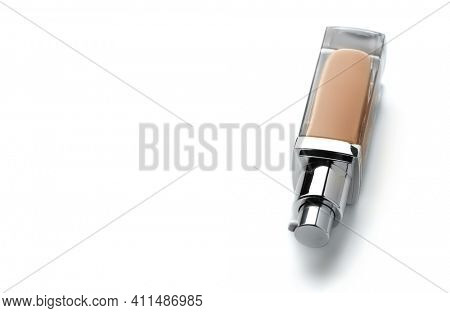Foundation face make-up sample. One glass transparent bottle of cosmetic liquid foundation or bb cream, Natural Light beige colour. Make up smear isolated on a white background