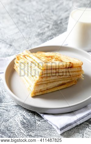 Crepes, Thin Pancakes On A Plate. Comfor Food, Delicious Homemade Breakfast With Thin Pancakes And M