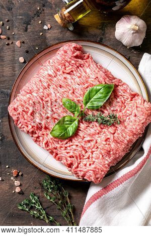Mince. Fresh Raw Minced Meat On A Plate And Wooden Background