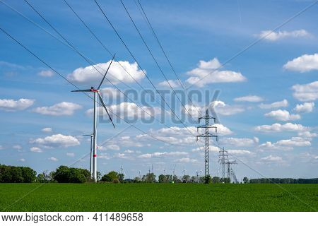 Overhead Power Line And Wind Turbines Seen In Germany