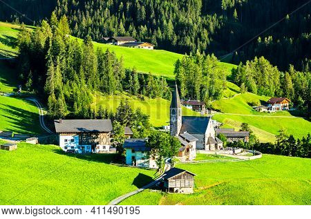 View Of Val Di Funes With The Chruch Of Santa Maddalena In The Dolomites Mountains. Unesco World Her