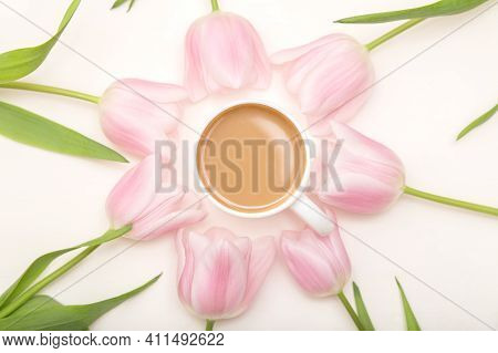 Morning Coffee Concept. Cup Of Coffee And Spring Flowers Around. Springtime Background.