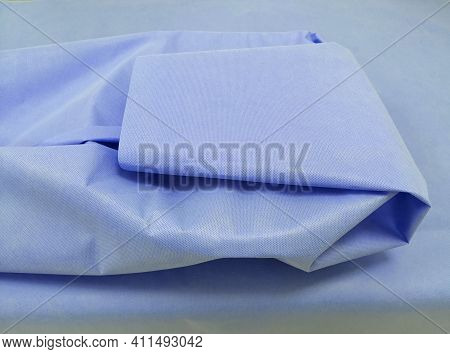 Packing Of Surgical Instrument With Sterilization Blue Drape Sheet. Selective Focus