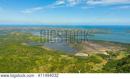 Top View Of Landscape With Farmland, Rice Fields Filled With Water. Agricultural Landscape In Asia P