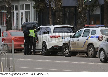Kyiv Ukraine - March 05 2021: Two Police Officers Stopped The Intruder's Car On A Busy City Street.