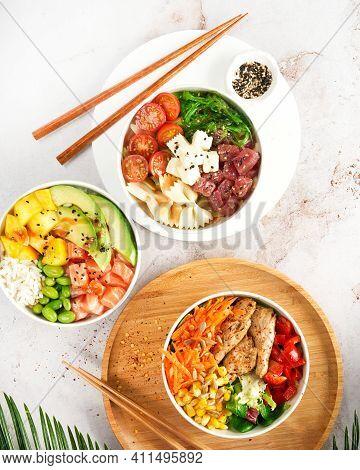 Asian Trendy Poke Bowls With Salmon, Tuna, Heura Soy Protein Vegan Chicken, Variety Vegetables, Serv