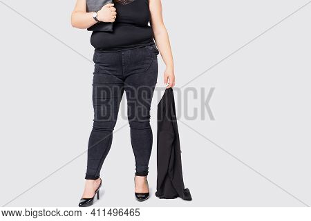 Cropped Photo Of Overweight Female Legs. Plus Size Model Girl Wearing Formal Suit And Black Shoes St