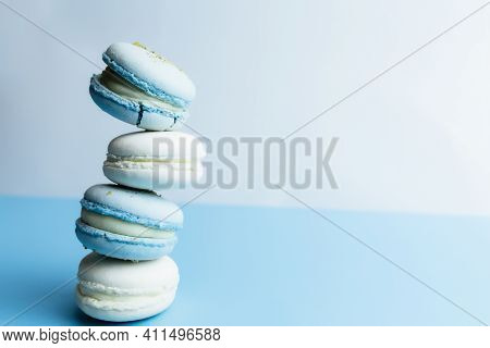 White And Blue Macaroons On The Table, Macaroons On White Blue Background