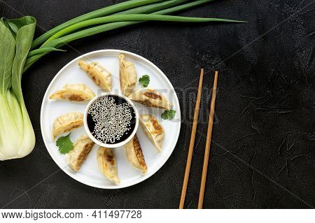 Fried Dumplings Gyoza With Soy Sauce, And Chopsticks, Top View. Vegetarian Recipe With Carrot, Bock
