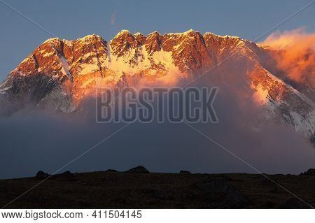 Nuptse South Rock Face In The Middle Of Clouds, Evening Sunset Panoramic View, Khumbu Valley, Nepal
