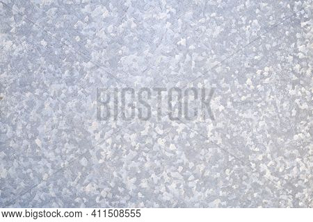 A Galvanized Steel Sheet In The Foreground. Industrial Background. Copy Space.
