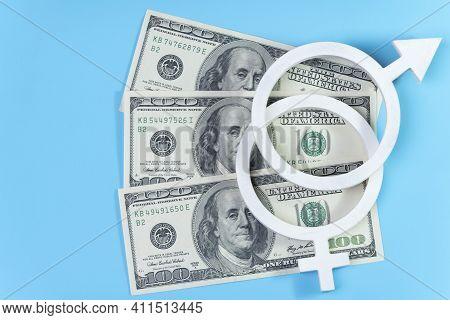 Equal Pay Concept. 100 Dollar Bills On Blue Background And Gender Equality Symbol