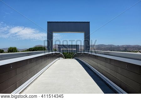 IRVINE, CALIFORNIA - 12 AUG 2020: Pedestrian Bridge over Irvine Boulevard allows hikers and cyclist to navagate the city while avoiding traffic.