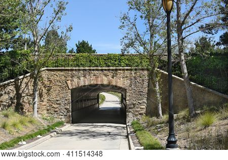 IRVINE, CA - MARCH 24, 2017: Jeffrey Open Space Trail tunnel. This open space corridor is one element in the citys overall open space system