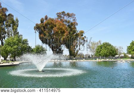 IRVINE, CA - MARCH 24, 2017: Heritage Park Lake. The park features, pools, sports fields, Mulit-use buildings, lawns, pond, amphitheater, and more.